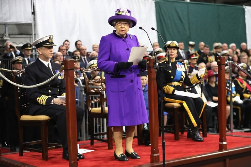 Britain's Queen Elizabeth II (C) gives an address as she attends the Commissioning Ceremony for the Royal Navy aircraft carrier HMS Queen Elizabeth at HM Naval Base in Portsmouth, southern England ( AFP Photo)