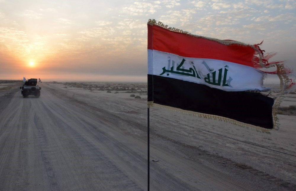 Iraqi government forces patrol in military vehicles in Salaheddin province as they take part in an offensive against the Daesh terrorist group, October 2016.