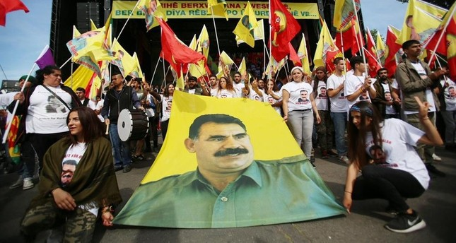 A group of terror supporters organize a gathering freely in Cologne, demonstrating PKK leader Öcalan's posters and PKK banners