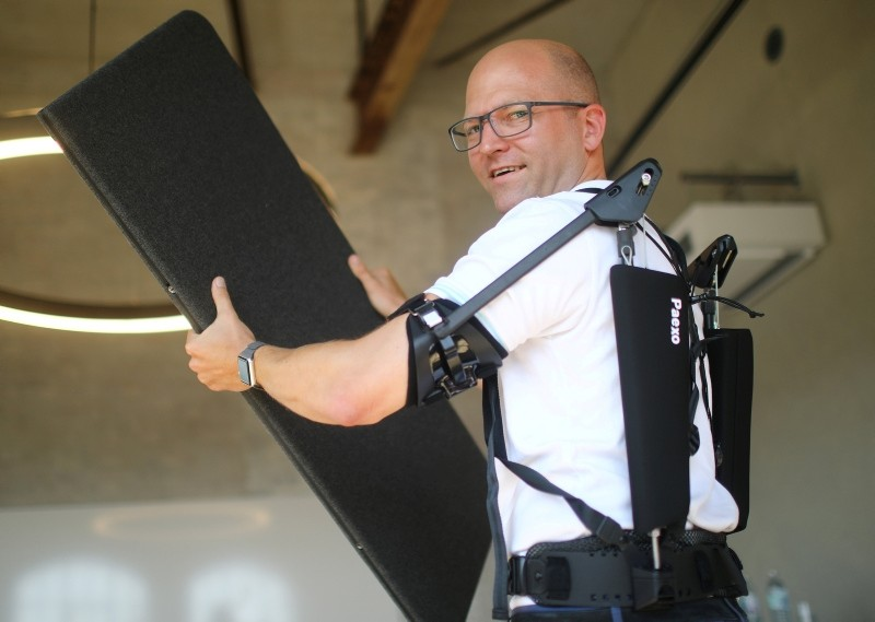 Soenke Rossing, Head of Industrials unit at German prosthetic limb maker Ottobock, presents an exoskeleton of the company during an interview with Reuters in Berlin, Germany, August 23, 2018. (Reuters)