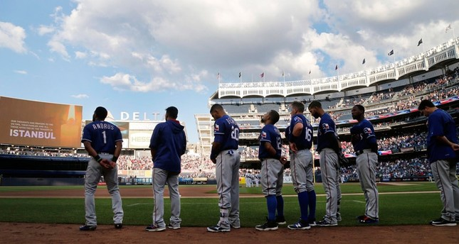Members of the Texas Rangers stand at attention while observing a moment of silence for victims of the Istanbul airport attacks before the start of a baseball game against the New York Yankees in New York, Wednesday, June 29, 2016
