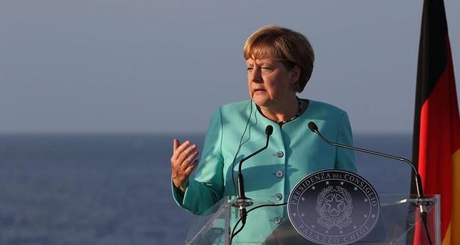 German Chancellor Angela Merkel speaks during a press conference at the end of their meeting on the Italian military ship 'Garibaldi' near Ventotene Island, Tirreno sea, Italy, Aug. 22, 2016. (EPA Photo)