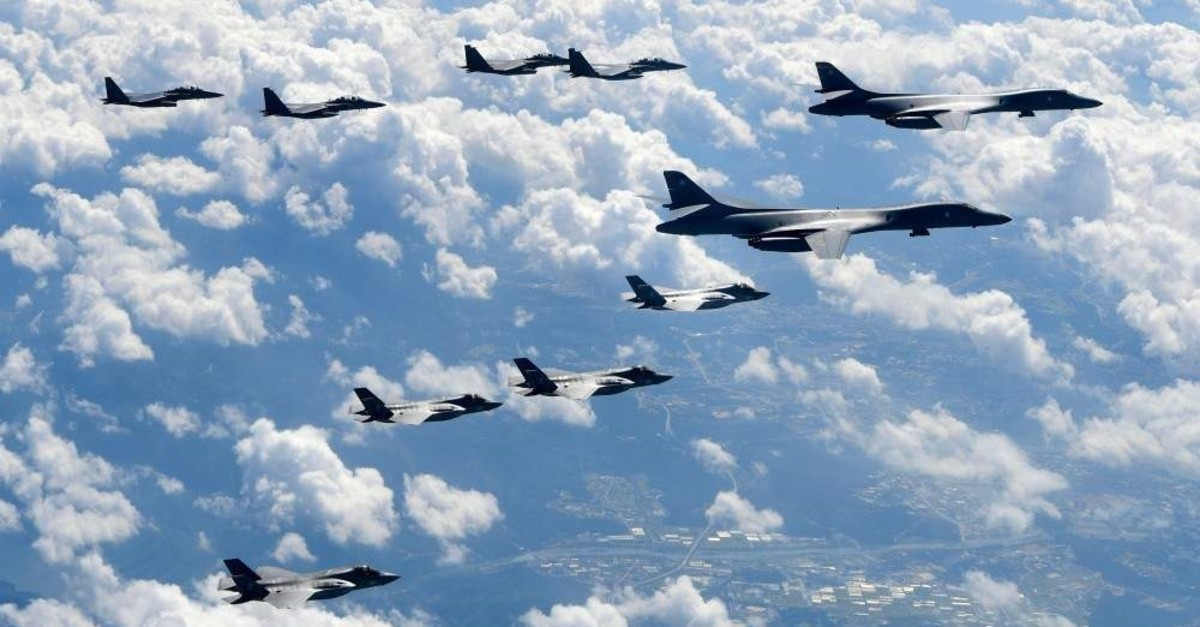 In this Sept. 18, 2017, file photo provided by South Korea Defense Ministry, U.S. Air Force B-1B bombers, F-35B stealth fighter jets and South Korean F-15K fighter jets fly over the Korean Peninsula during joint drills. (South Korea Defense Ministry via AP)
