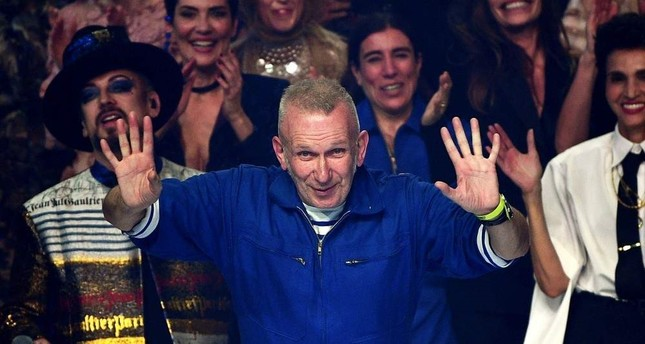 French designer Jean Paul Gaultier acknowledges the audience at the end of his Women's Spring-Summer 2020 Haute Couture collection fashion show in Paris, on Jan. 22, 2020. AFP Photo