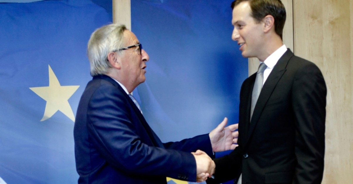 Senior Advisor to the President of the United States Jared Kushner, right, shakes hands with European Commission President Jean-Claude Juncker prior to a meeting at EU headquarters in Brussels, Tuesday, June 4, 2019. (AP Photo)