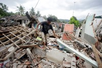 Indonesia's Lombok island lifted 10 inches by magnitude 7 quake that killed 387