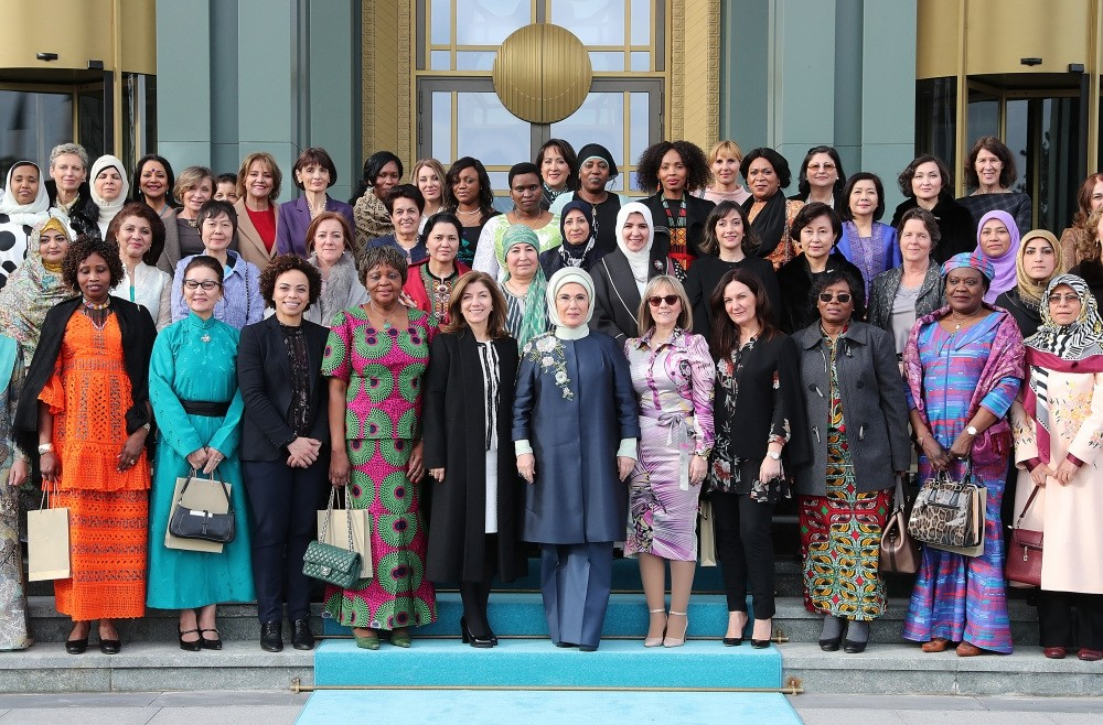 First lady Emine Erdou011fan (C) alongside the spouses of foreign envoys and female ambassadors following an event at the Beu015ftepe Presidential Complex, Ankara, Feb. 13, 2019.