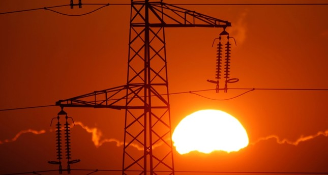 Electrical power pylons of high-tension electricity power lines are seen at sunset in Cambligneul near Arras, France.