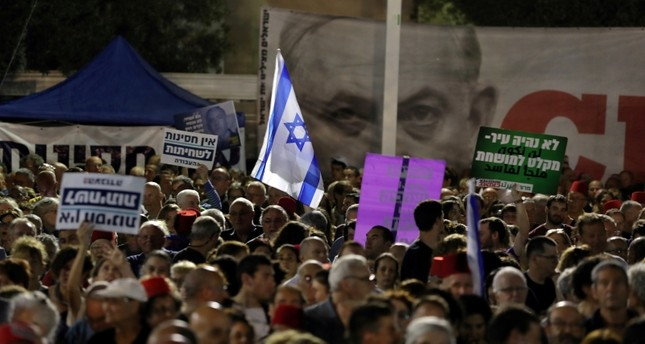 Tens of thousands protest Netanyahu immunity bill