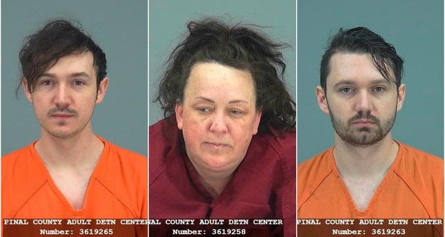 Logan Hackney (L) and his brother Ryan Hackney were arrested on suspicion of failing to report abuse of a minor by their mother Machelle Hackney. (Pinal County Sheriff's Office via AP)