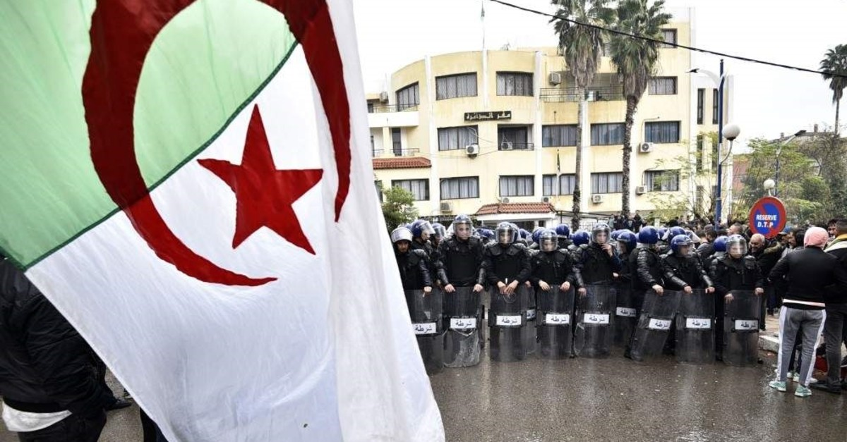Security forces face Algerian demonstrators gathered, east of the capital Algiers, Dec. 8, 2019, (AFP Photo)