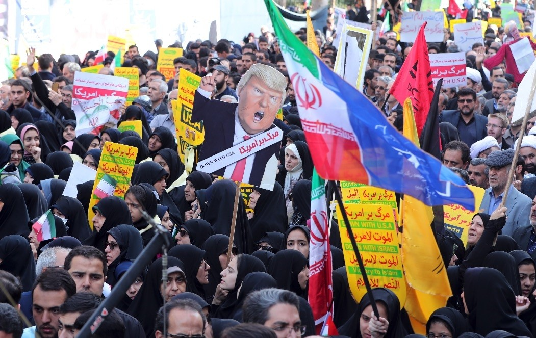 Iranians hold a placard showing a caricature of U.S. President Donald Trump during an anti-U.S. demonstration marking the 39th anniversary of the U.S. Embassy takeover in Iran, Nov. 4.