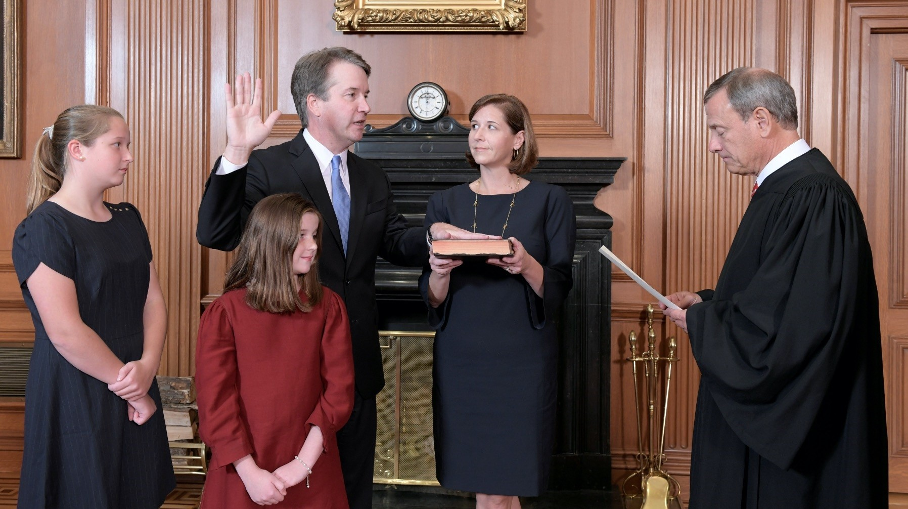 Judge Brett Kavanaugh is sworn in as an Associate Justice of the U.S. Supreme Court by Chief Justice John Roberts as Kavanaughu2019s family look on at the U.S. Supreme Court building, Washington, D.C. Oct. 6.