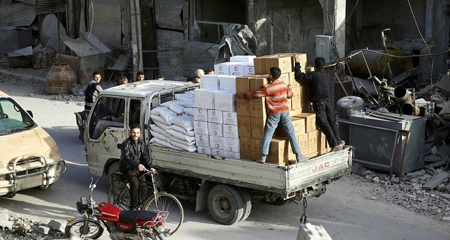 A pick-up truck loaded with humanitarian aid arrives at the besieged town of Douma, Eastern Ghouta, Damascus, Syria March 5, 2018. (REUTERS Photo)