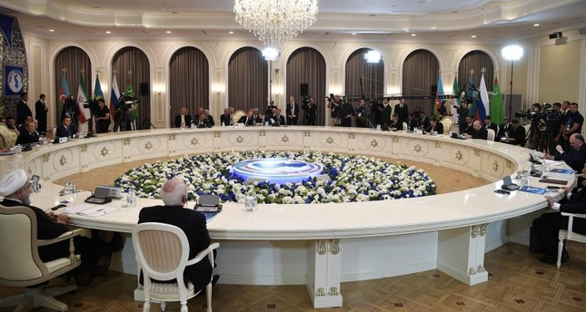 Heads of the Caspian region countries take part in a plenary session during the 5th Caspian Summit in Aktau on August 12, 2018. (Photo by Alexey Nikolsky / Sputnik / AFP)
