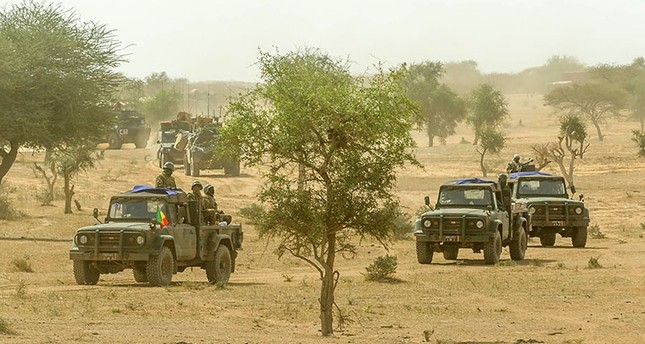 This photo handout by the French ECPAD and taken on Nov. 3, 2017 in the Malian desert, shows a convoy of Malian military vehicles taking part in the 'Hawbi' joint tactical coordination operation with soldiers of France's Barkhane mission. (AFP Photo)