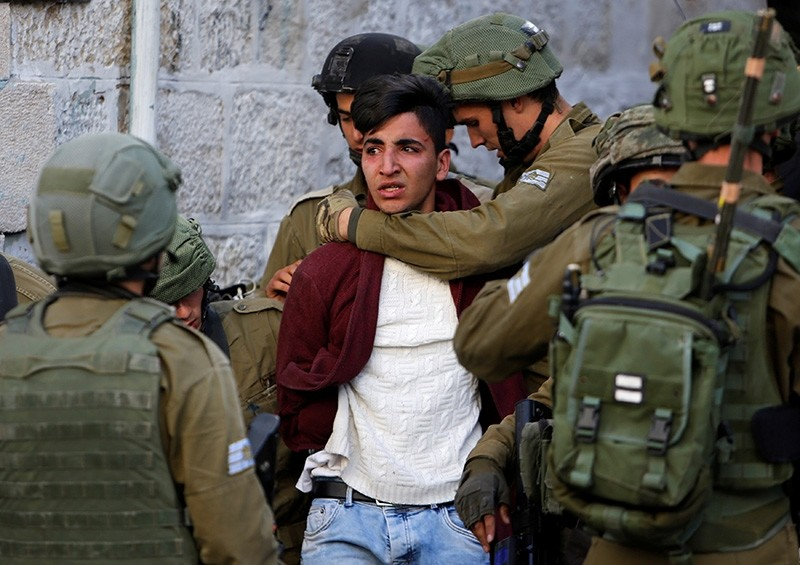 Israeli soldiers detain a Palestinian during clashes at a protest against U.S. President Donald Trump's decision to recognize Jerusalem as the capital of Israel, in the West Bank city of Hebron, Dec. 10, 2017. (Reuters Photo)