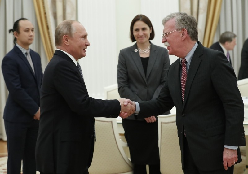 Russian President Vladimir Putin shakes hands with John Bolton, National Security Adviser to the US President, during a meeting at the Kremlin in Moscow on October 23, 2018. (AFP Photo)