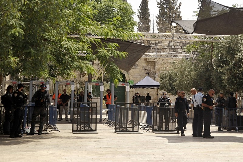 Israeli border police officers stand near newly installed cameras at the entrance to the Al Aqsa Mosque compound, in Jerusalem's Old City, Sunday, July 23, 2017 (AP Photo)