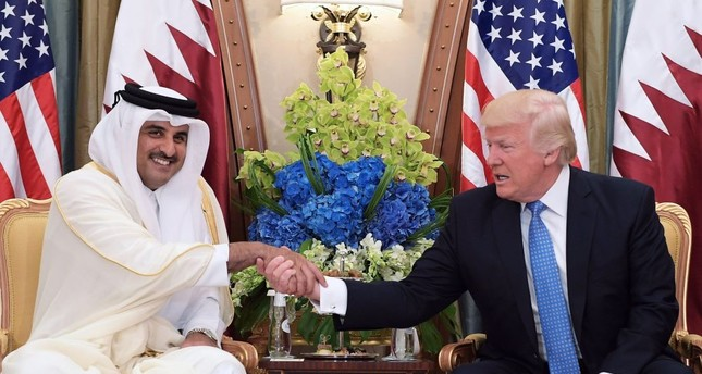 This file photo taken on May 21, shows U.S. President Donald Trump shaking hands with Qatar's Emir Sheikh Tamim Bin Hamad Al-Thani, during a bilateral meeting at a hotel in the Saudi capital Riyadh.