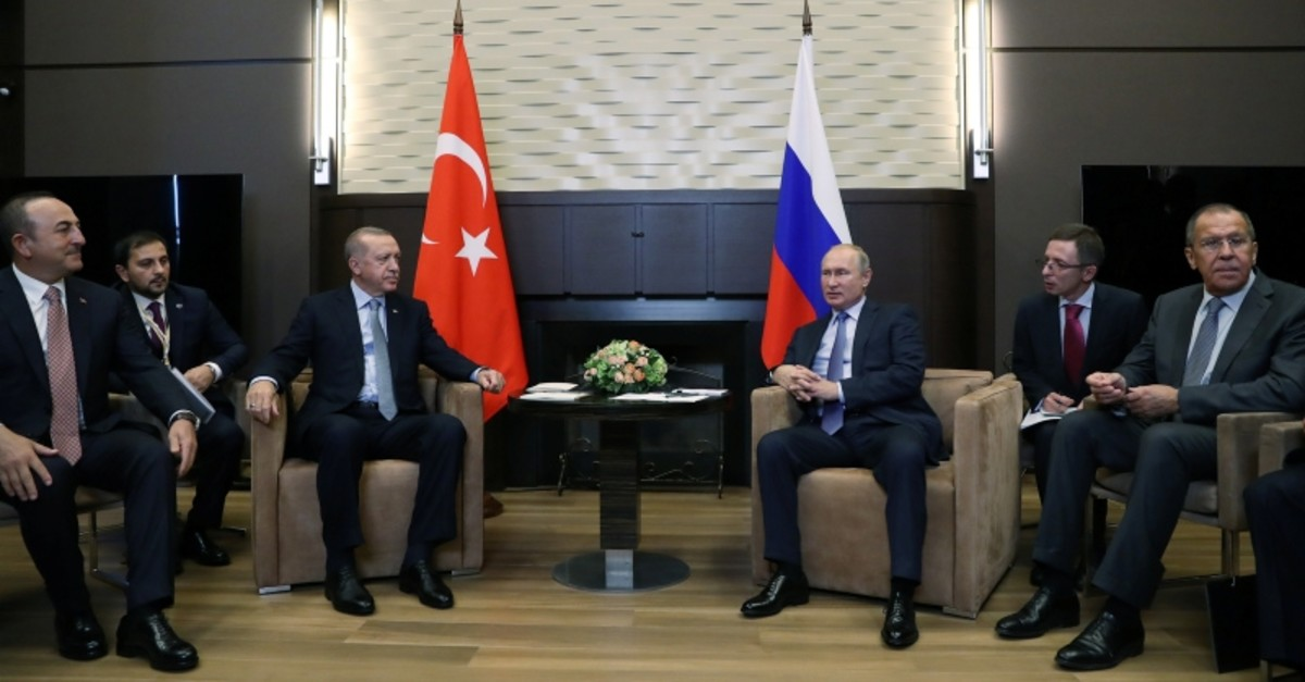 President Recep Tayyip Erdou011fan, left, meets with his Russian counterpart Vladimir Putin in Sochi, Russia, Oct. 22, 2019. (Pool Photo via Reuters)