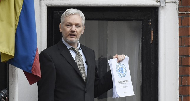 A file picture dated 05 February 2016 shows Julian Assange speaking to the media from a balcony of the Ecuadorian Embassy in London, Britain. (EPA Photo)