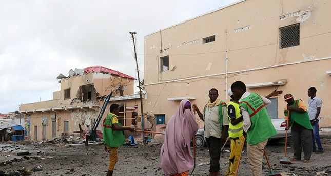 Workers clear debris at the scene of an explosion at the gate of Siyad hotel after Friday night's attack in Somalia's capital Mogadishu, July 11, 2015. (Reuters Photo)