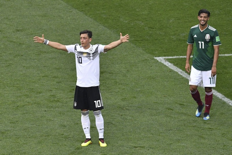 Germany's midfielder Mesut Ozil (L) reacts during the Russia 2018 World Cup Group F football match between Germany and Mexico at the Luzhniki Stadium in Moscow on June 17, 2018. (AFP PHOTO)
