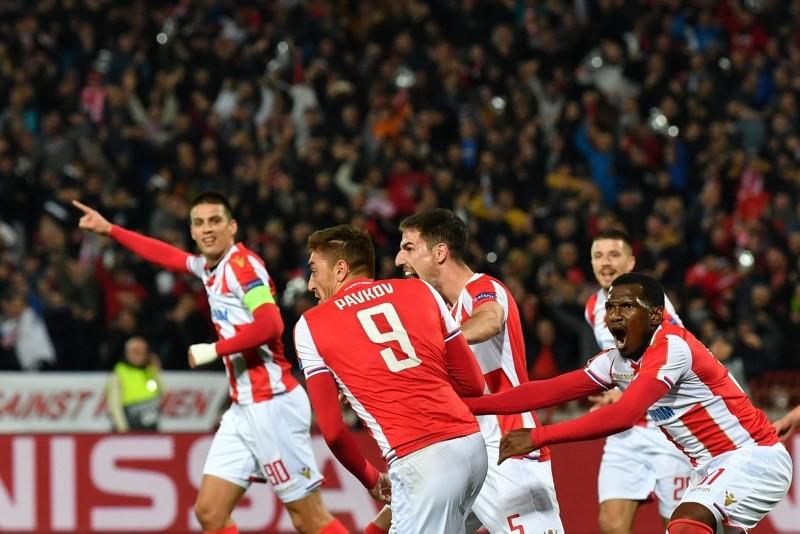 Red Star Belgrade's Serbian forward Milan Pavkov (C) celebrates after scoring a goal during the UEFA Champions League Group C second-leg football match. (AFP Photo)