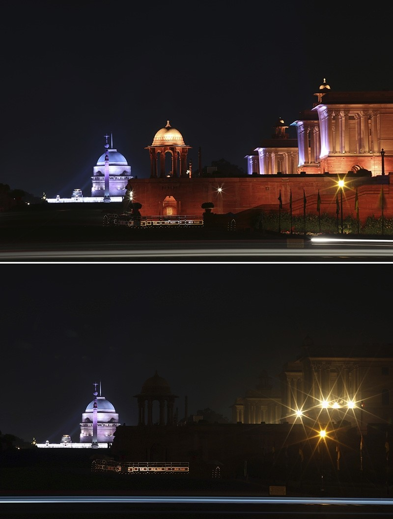 In this two photo combination picture, North Block, buildings that house India's seat of power, are seen lit, top, and then the same location in darkness when the lights are turned out for one hour to mark Earth Hour, in New Delhi, India, Saturday, March 24, 2018 (AP Photo)
