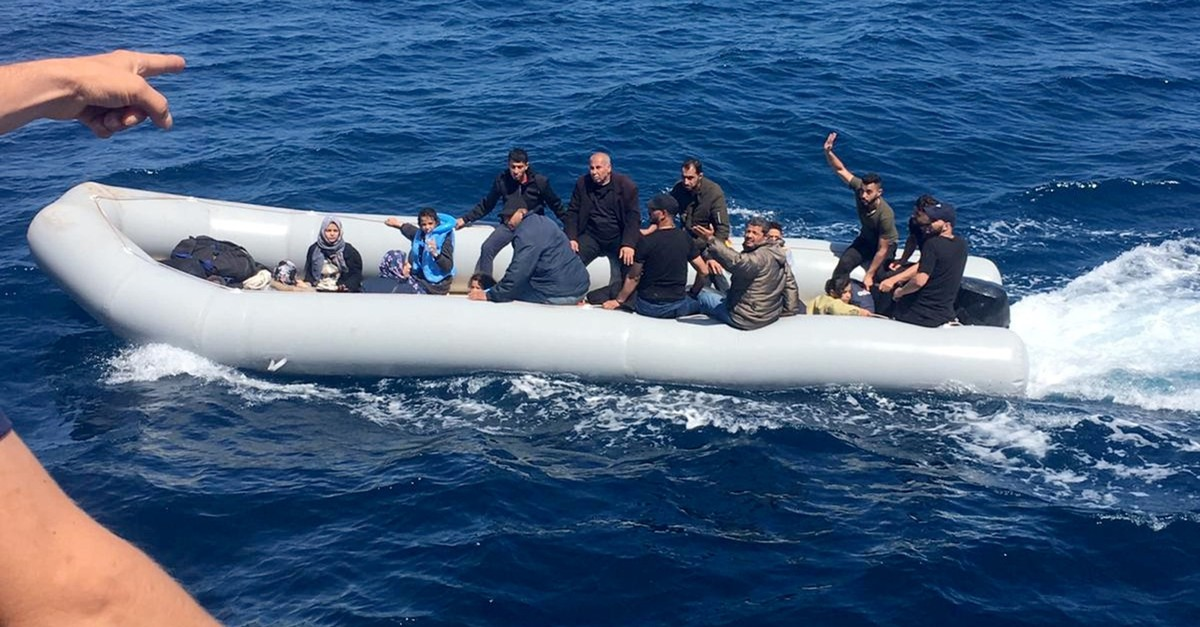 Coast Guard officers confront illegal migrants aboard a boat off the coast of Didim in Aydu0131n province, June 1, 2019.