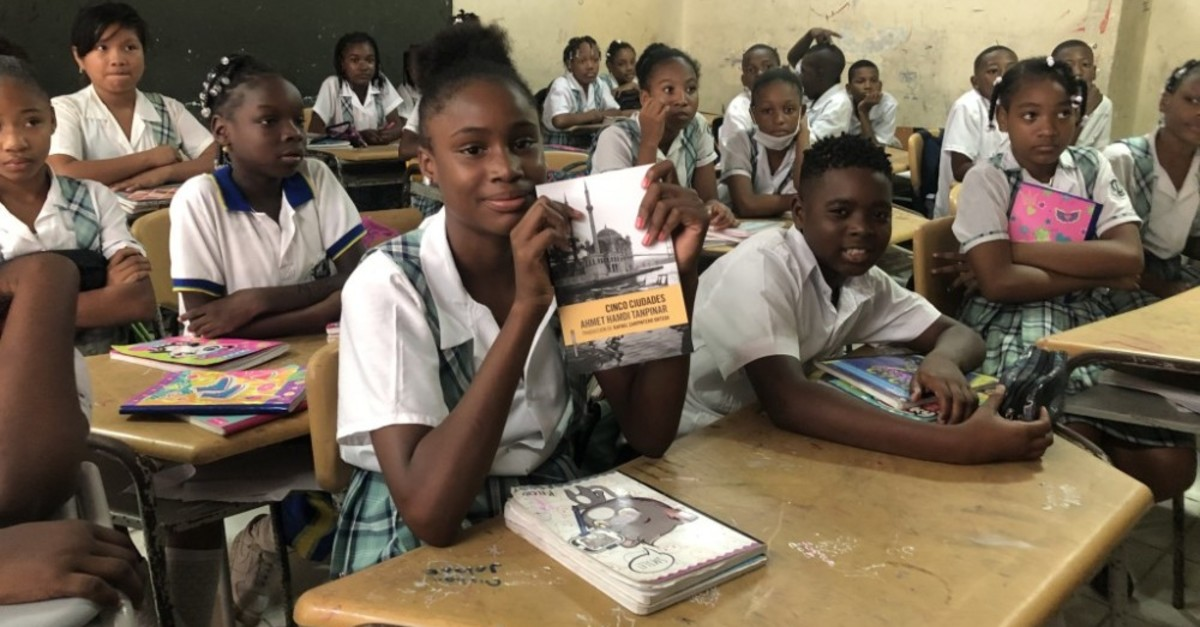 Students at Andres Bello primary school show books and stationary handed out by Tu0130KA, March 31, 2019.