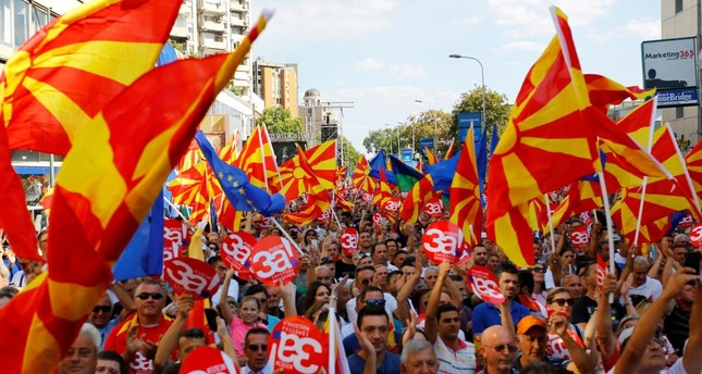 People hold placards reading 'Yes for European Macedonia' during a march in support of a referendum on changing the country's name and its NATO and EU membership bids in Skopje, Macedonia September 16, 2018. (Reuters Photo)