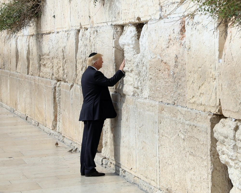 U.S. President Donald Trump touches the Western Wall, Judaism's holiest prayer site, in Jerusalem's Old City. Many protests against Trump's decision to move his country's embassy to Jerusalem were portrayed as anti-Semitic.