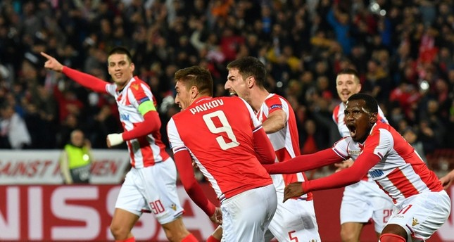 Red Star Belgrade's Serbian forward Milan Pavkov (C) celebrates after scoring a goal during the UEFA Champions League Group C second-leg football match. (AFP Photo)
