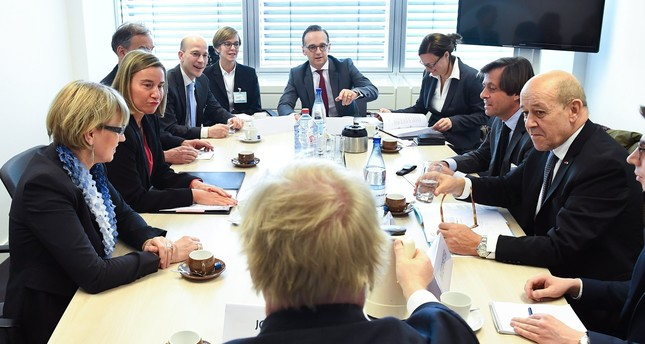 Germany's Foreign Minister Heiko Maas (C), Britain's Foreign Secretary Boris Johnson (front, back to camera), France's Jean-Yves Le Drian (R) and EU foreign policy chief Federica Mogherini (2-L, back) meel in Luxembourg. EPA Photo)