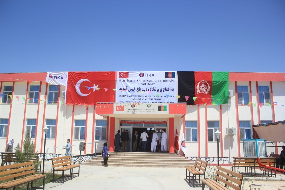 Turkish, Afghan flags adorn the exterior of orphanage (AA Photo).