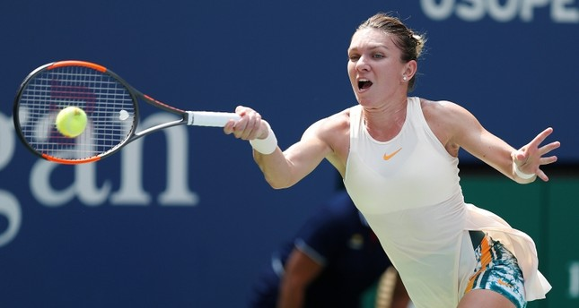 Simona Halep of Romania hits a return to Kaia Kanepi of Estonia during the first day of the US Open Tennis Championships, in New York, USA, 27 August 2018. (EPA Photo)