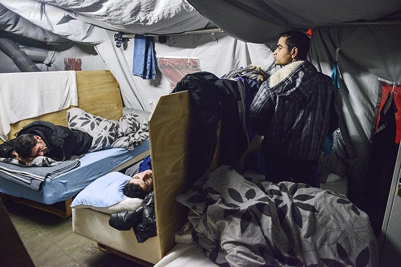 A file photo dated 13 January 2016 showing refugees in their beds at the refugee tent camp in Thisted, Northern Jutland, Denmark. (EPA Photo)
