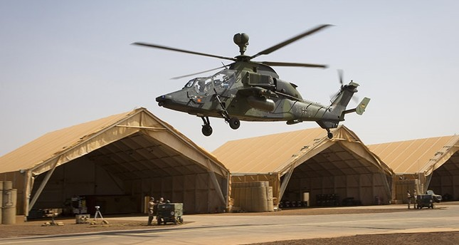 A handout photo made available by the German Bundeswehr armed forces shows a Tiger combat helicopter landing in a camp during MINUSMA mission in Gao, Mali, March 25, 2017. (EPA Photo)