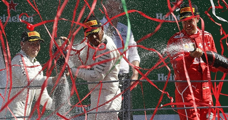 Mercedes driver Lewis Hamilton (C), winner of the Italian Formula One Grand Prix, celebrates with 2nd placed teammate Valtteri Bottas (L) and 3rd placed Ferrari driver Sebastian Vettel at the Monza racetrack, Italy, Sunday, Sept. 3, 2017. (AP Photo)
