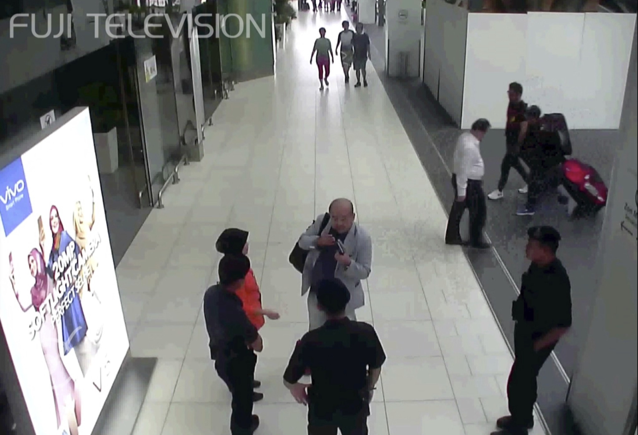 Footage from Kuala Lumpur airport security cameras obtained by Fuji TV, Kim Jong Nam talks to airport security and officials after he was attacked. (Fuji TV via AP)