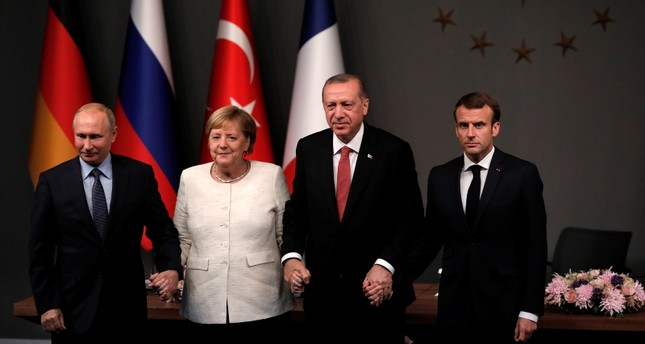 From left: Russian President Vladimir Putin, German Chancellor Angela Merkel, Turkish President Recep Tayyip Erdoğan and French President Emmanuel Macron pose for a photo ahead of a summit on Syria, in Istanbul, on Oct. 27, 2018. (DHA Photo)