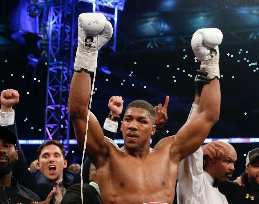Anthony Joshua celebrates after winning the world heavyweight title.