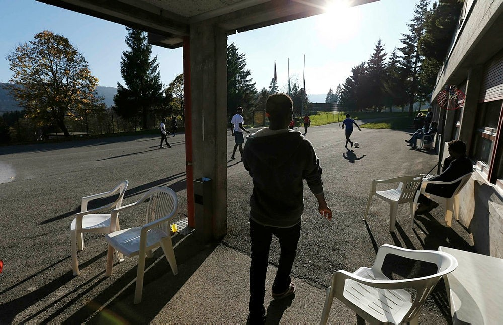 Asylum seekers play football at a reception centre in Provence, Switzerland, Oct. 28, 2014. (Reuters Photo)
