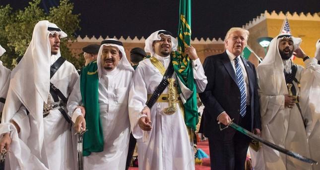 President Donald Trump (2nd R) with Saudi Arabia's King Salman bin Abdulaziz (2nd L) during a welcome ceremony with traditional sword dancers at the Murabba Palace in Riyadh, Saudi Arabia on May 20.