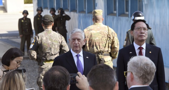 U.S. Defense Secretary Jim Mattis, center, speaks to the media with South Korean counterpart Song Young-moo, right, on the border between North and South Korea Friday, Oct. 27, 2017. (AP Photo)