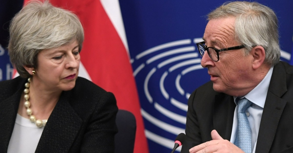 European Commission President Jean-Claude Juncker (R) and British Prime Minister Theresa May give a press conference following their meeting in Strasbourg, on March 11, 2019. (AFP Photo)