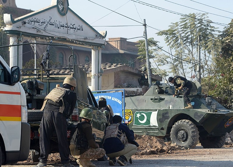 Pakistani security personnel take position outside an Agriculture Training Institute after an attack by Taliban militants in Peshawar, Pakistan, Dec. 1, 2017. (AFP Photo)