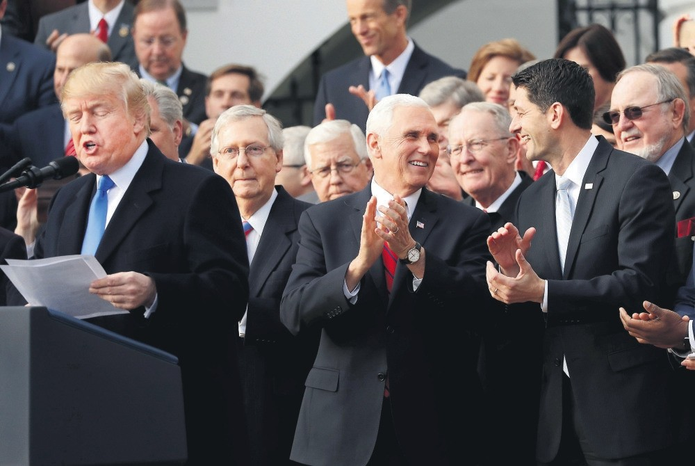 U.S. President Trump (L) celebrates with congressional Republicans after U.S. Congress passed sweeping tax overhaul legislation, Washington, Dec. 20 2017.